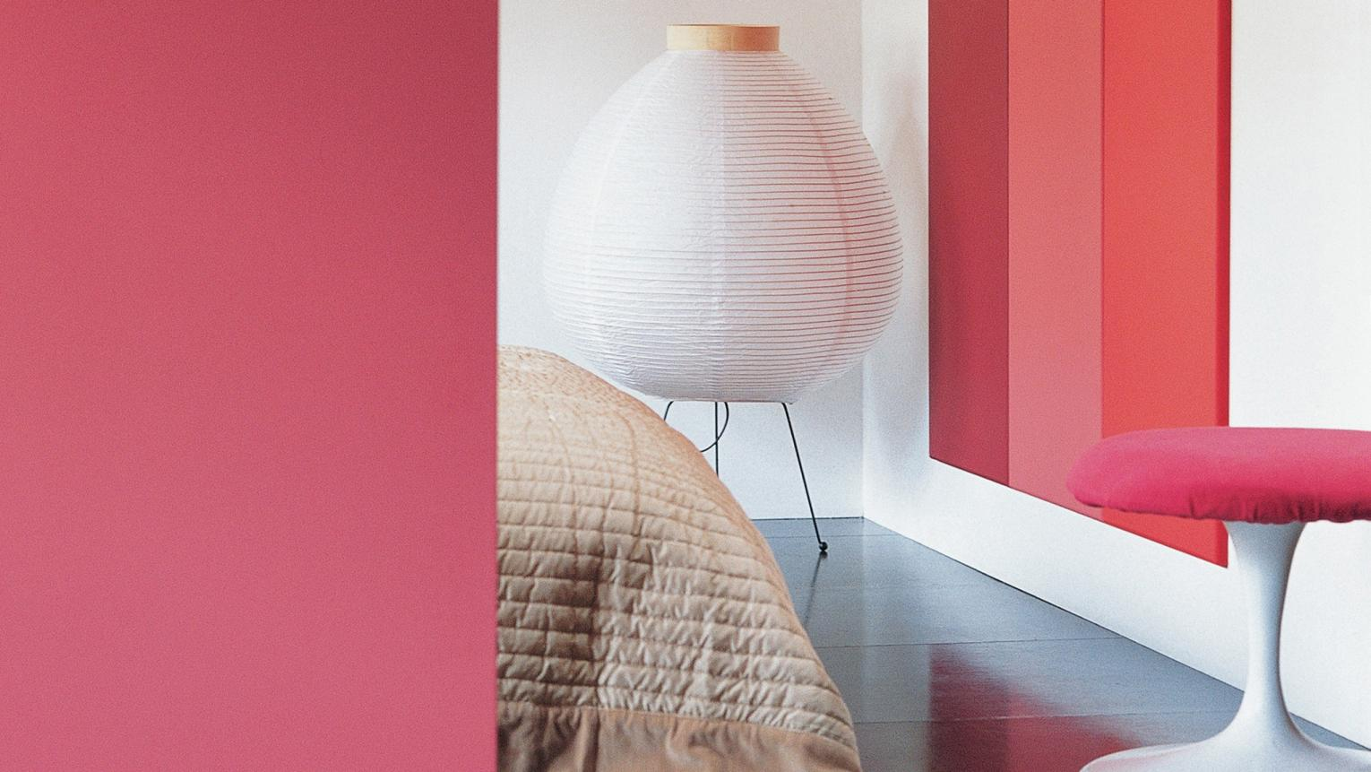 A spectrum of red shades brings an delightful mood to the bedroom.