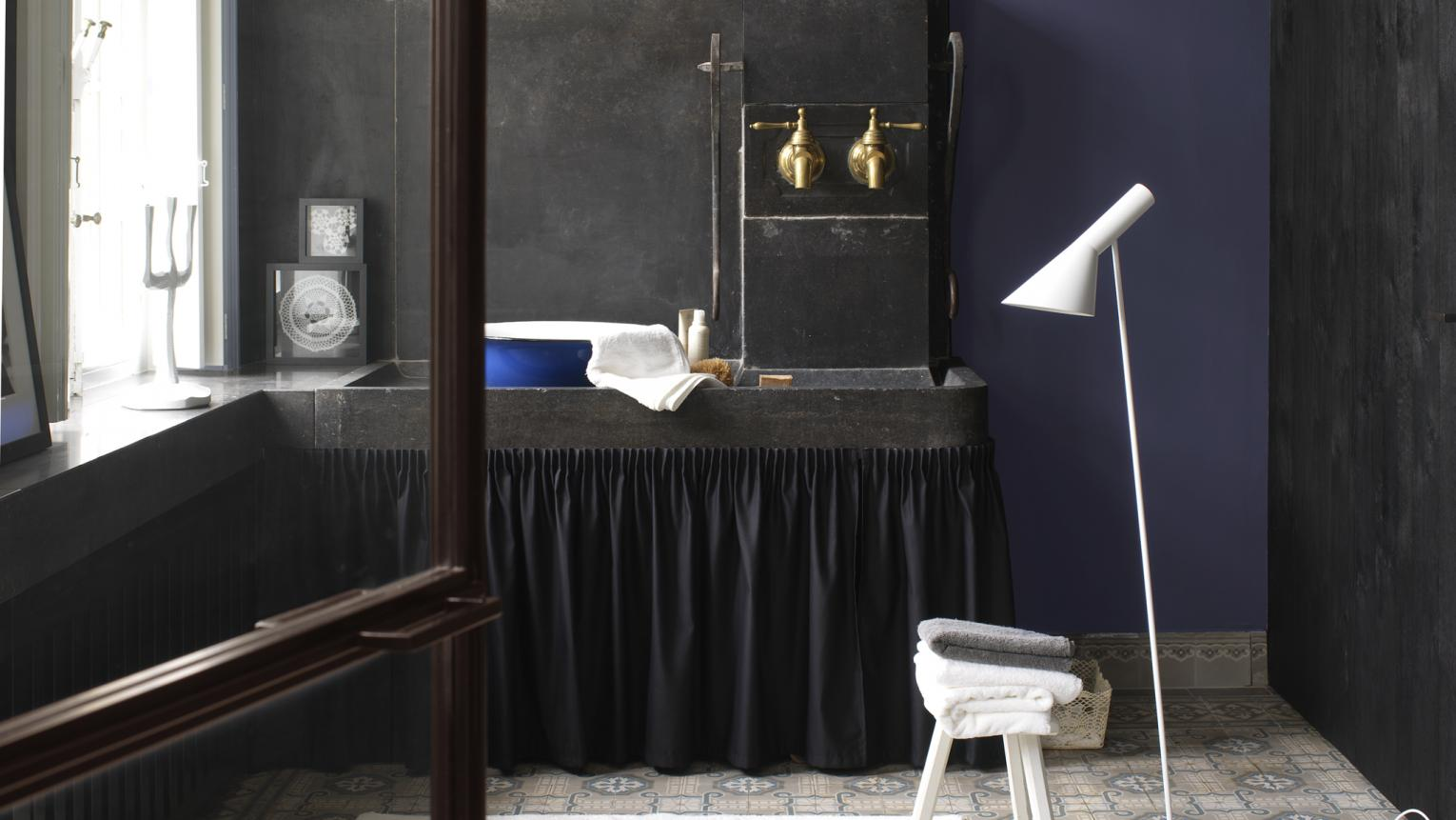 Be bold with deep, intense shades for an opulent bathroom look.