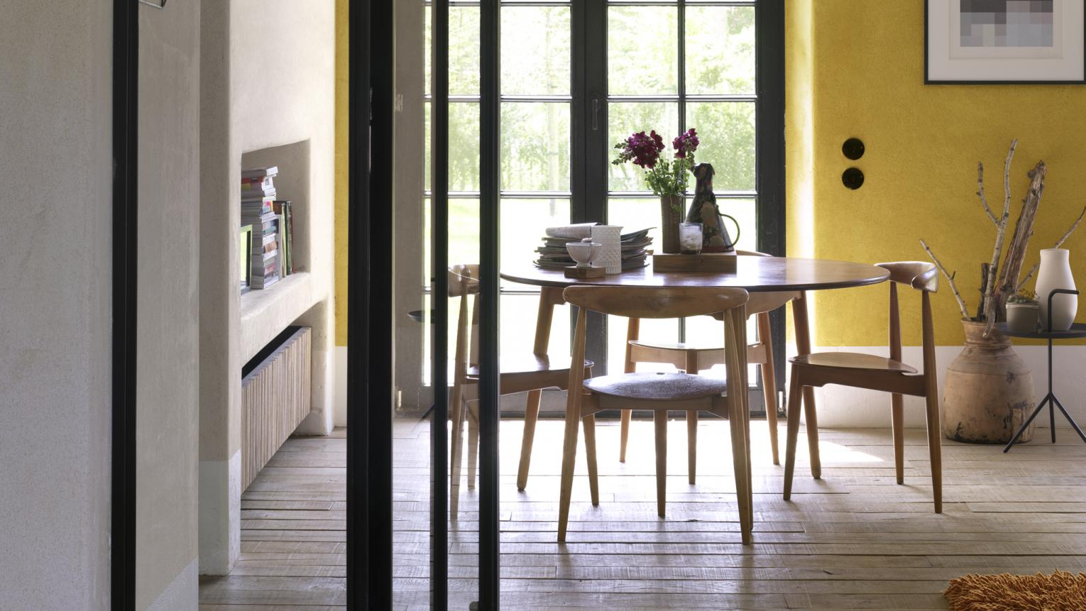 For a dining space that's full of cheer, look to warm yellow colour schemes.