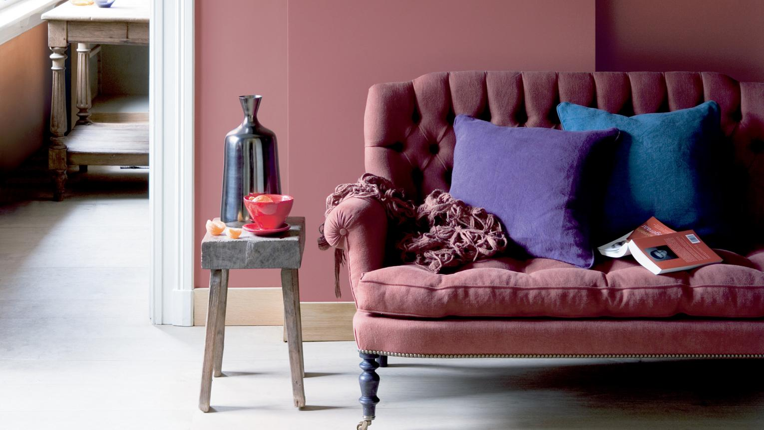 Accessorise a dark pink living room with rich, jewel shades.