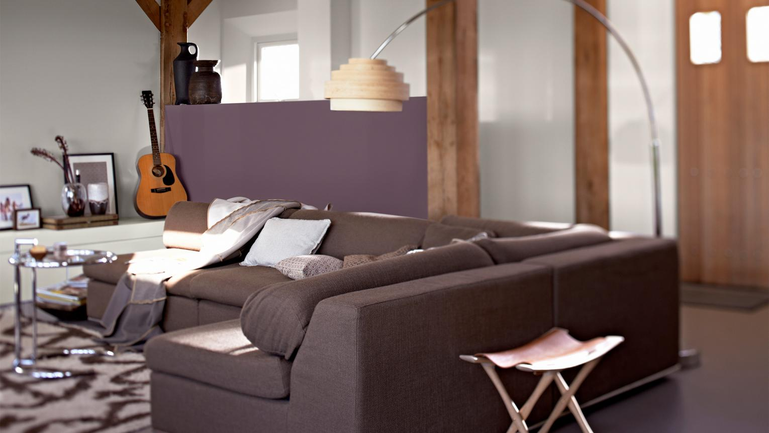 Decorating an open plan living room? Use colour schemes to define different areas in an open-plan room.