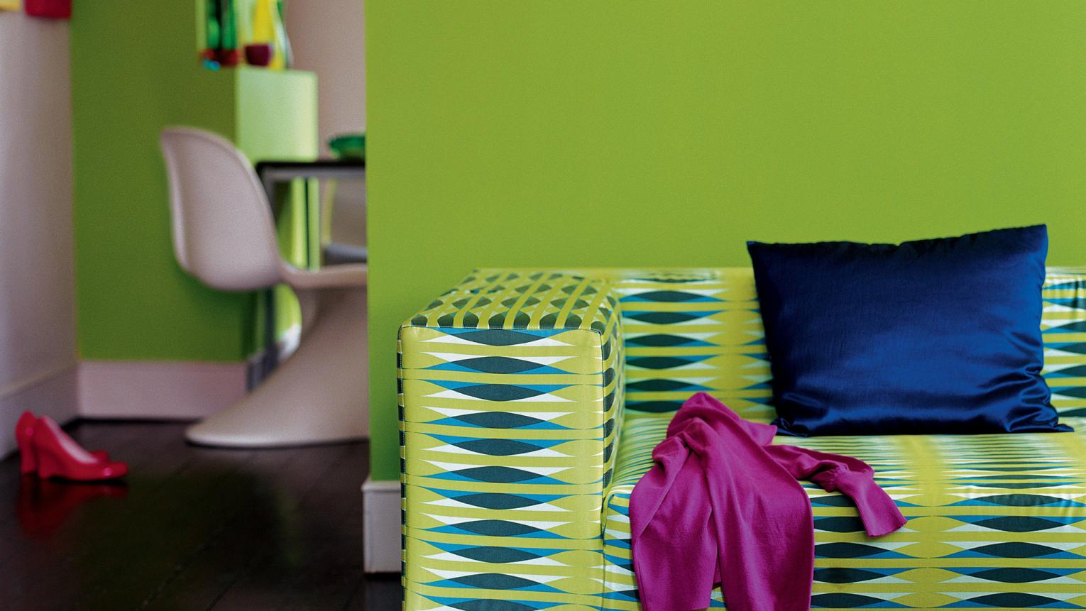 Pair a captivating lime green wall with dramatic dark wood floors.