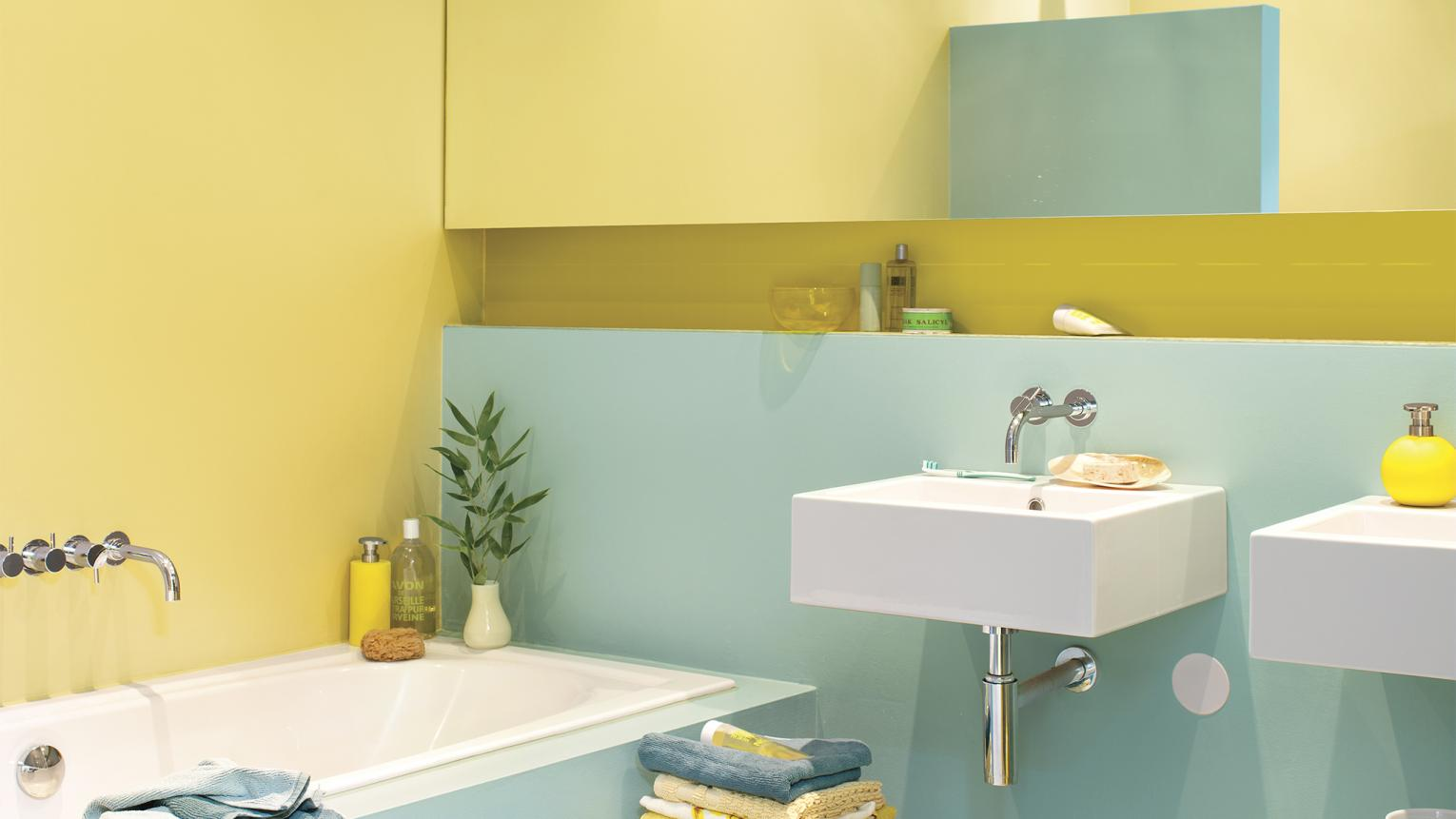 If your bathroom is more squeezy than breezy, look to a colour scheme that combines pale shades with bright pops of colours.