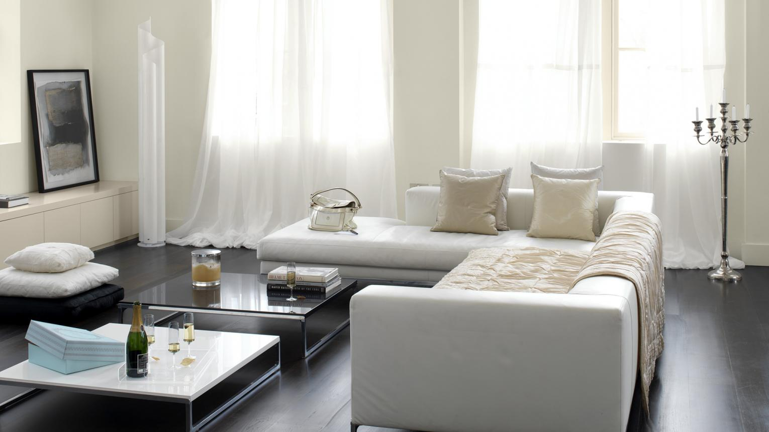 Choose subtle whites to flood a living room with natural light.
