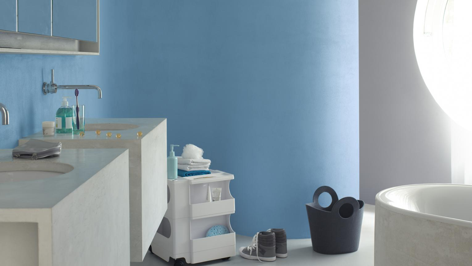 Refreshing aqua blue with soft grey creates a calm bathroom.