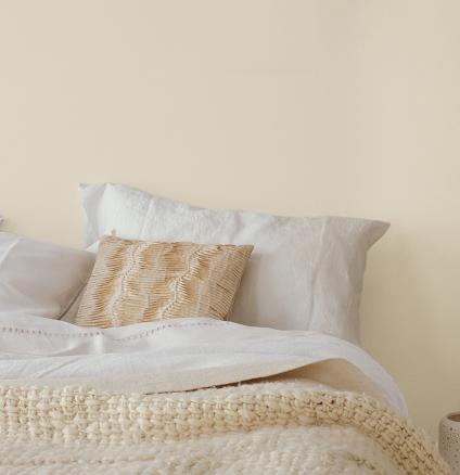 Pair a neutral colour palette with pops of colour to create a couple-friendly bedroom.